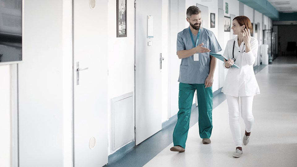 Doctors walking in hallway of hospital