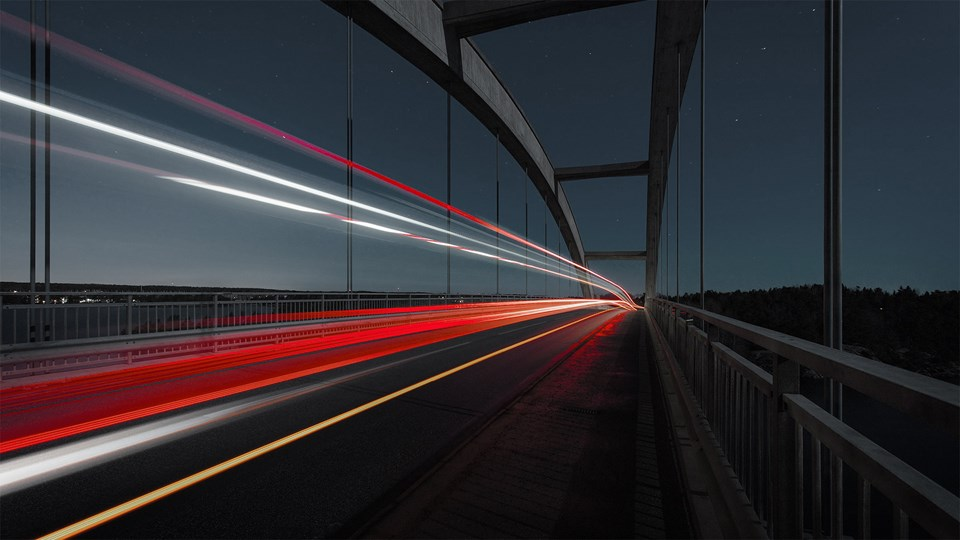 Car lights on bridge at night