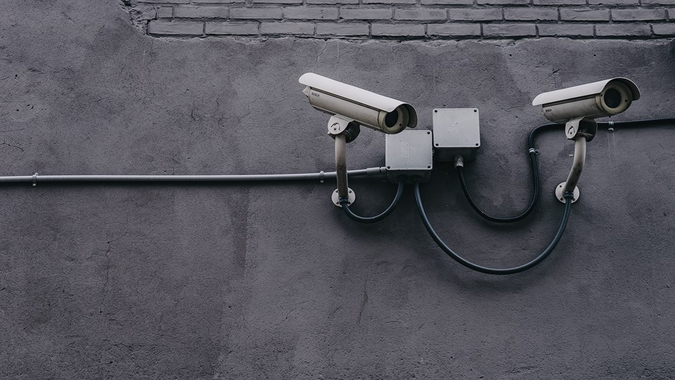 cybersecurity technology, cameras on grey wall